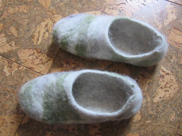 Felted slippers; made with pygora fiber that's removed during the dehairing process.